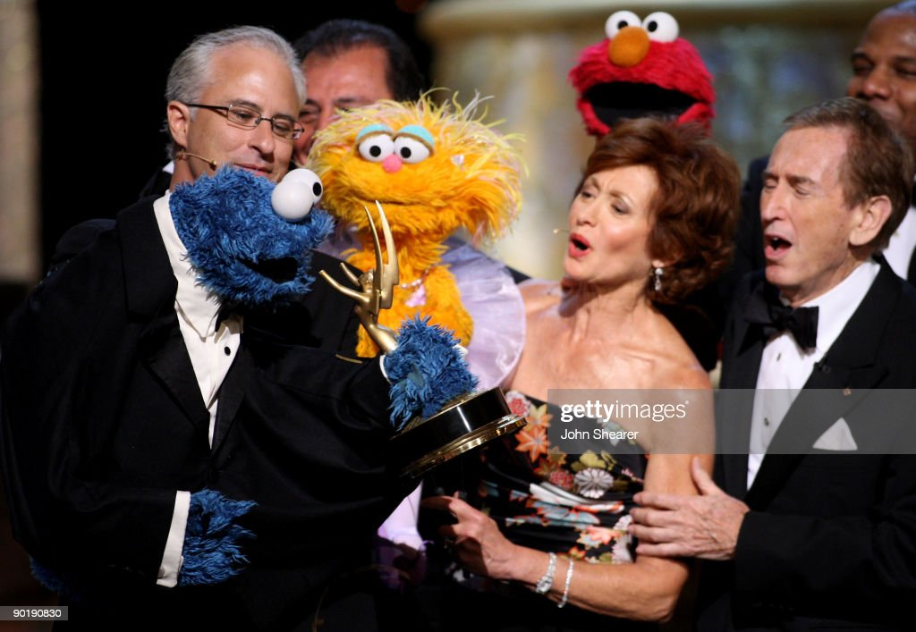 Actors/puppeteers David Rudman (L) with 'Cookie Monster ' and Fran Brill with 'Zoe' accept the Emmy for Lifetome Achievement Award at the 36th Annual Daytime Emmy Awards at The Orpheum Theatre on August 30, 2009 in Los Angeles, California.