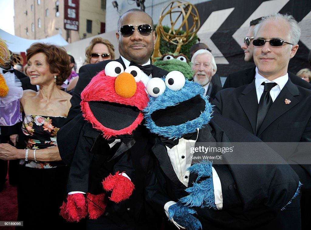 Actors/puppeteers Kevin Clash with 'Elmo' (L) and David Rudman with 'Cookie Monster ' arrive at the 36th Annual Daytime Emmy Awards at The Orpheum Theatre on August 30, 2009 in Los Angeles, California.