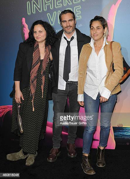 Actors/siblings Rain Phoenix Joaquin Phoenix and Summer Phoenix arrive at the premiere of 'Inherent Vice' at TCL Chinese Theatre on December 10 2014...