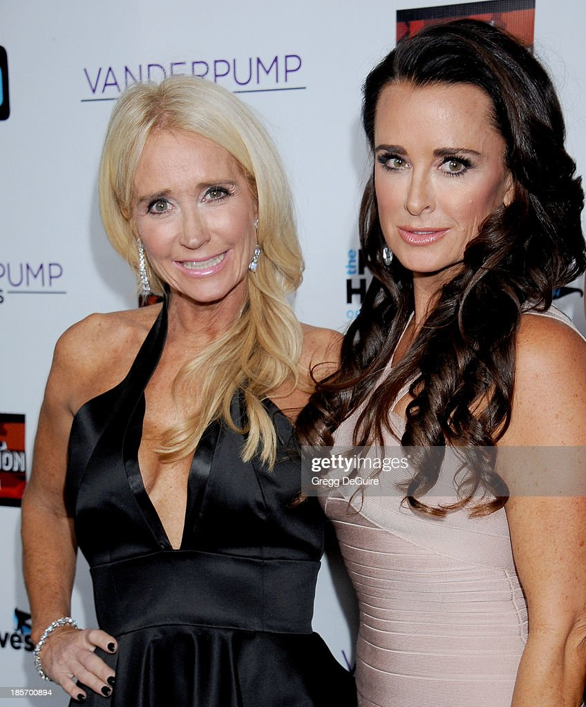 Actors/TV personalities <a gi-track='captionPersonalityLinkClicked' href=/galleries/search?phrase=Kim+Richards&family=editorial&specificpeople=689572 ng-click='$event.stopPropagation()'>Kim Richards</a> and <a gi-track='captionPersonalityLinkClicked' href=/galleries/search?phrase=Kyle+Richards&family=editorial&specificpeople=2586434 ng-click='$event.stopPropagation()'>Kyle Richards</a> arrive at 'The Real Housewives Of Beverly Hills' And 'Vanderpump Rules' premiere party at Boulevard3 on October 23, 2013 in Hollywood, California.
