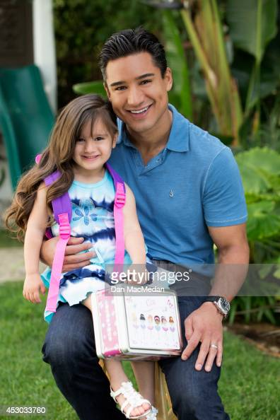 Actor/TV host Mario Lopez is photographed with his daughter Gia for USA Today's Back To School Magazine on July 15 2014 in Glendale California