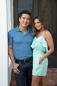 Actor/TV host Mario Lopez is photographed with his wife Courtney at their home for USA Today's Back To School Magazine on July 15 2014 in Glendale...