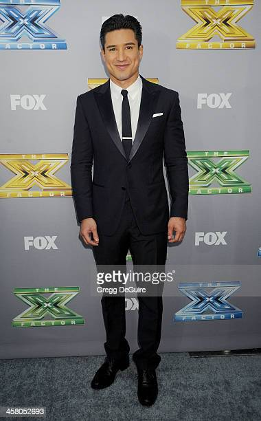 Actor/TV personality Mario Lopez attends FOX's 'The X Factor' season finale at CBS Television City on December 19 2013 in Los Angeles California