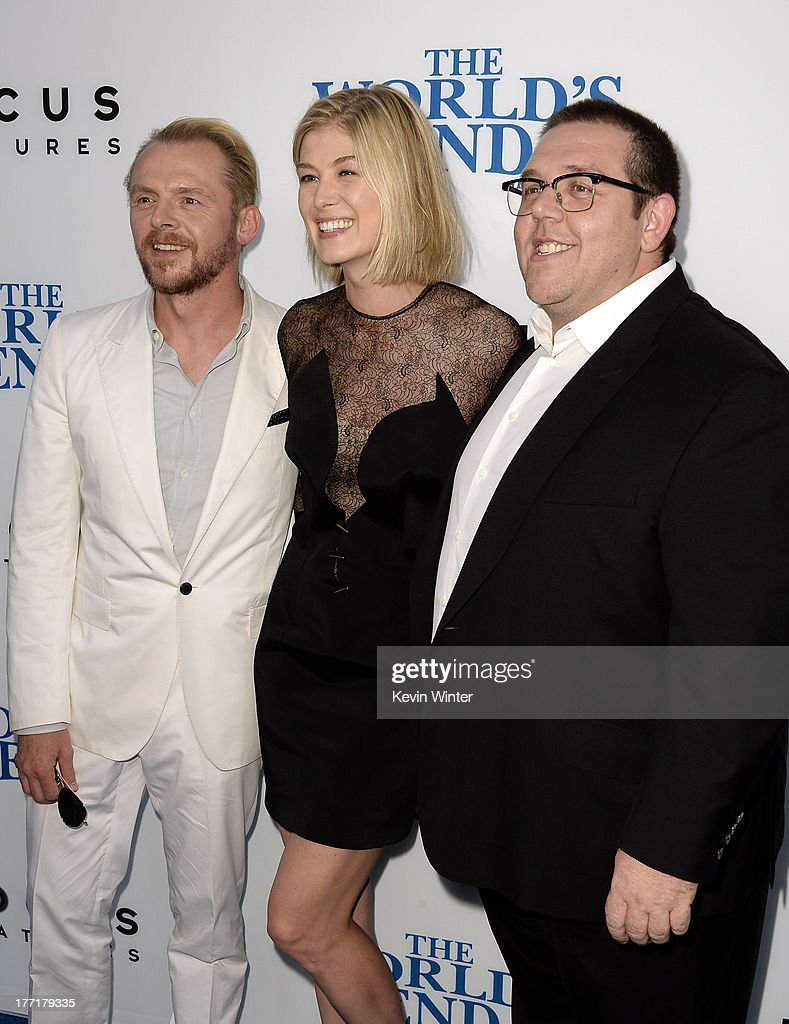 Actor/writer <a gi-track='captionPersonalityLinkClicked' href=/galleries/search?phrase=Simon+Pegg&family=editorial&specificpeople=206280 ng-click='$event.stopPropagation()'>Simon Pegg</a>, actress <a gi-track='captionPersonalityLinkClicked' href=/galleries/search?phrase=Rosamund+Pike&family=editorial&specificpeople=208910 ng-click='$event.stopPropagation()'>Rosamund Pike</a>, and actor Nick Frost arrive at the premiere of Focus Features' 'The World's End' at ArcLight Cinemas Cinerama Dome on August 21, 2013 in Hollywood, California.