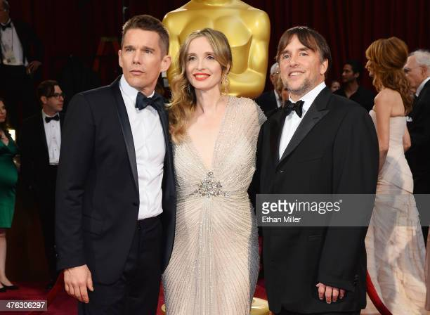 Actor/writers Ethan Hawke and Julie Delpy and filmmaker Richard Linklater attend the Oscars held at Hollywood Highland Center on March 2 2014 in...