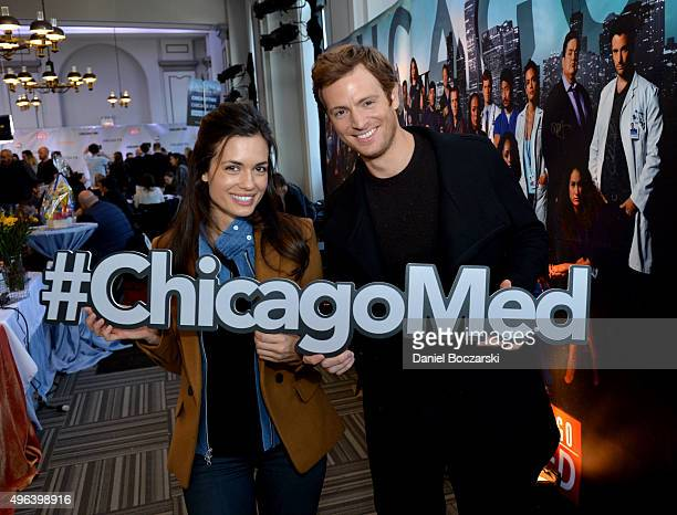 Actos Torrey DeVitto and Nick Gehlfuss pose with a #ChicagoMed hashtag as they attend a press junket for NBC's 'Chicago Fire' 'Chicago PD' and...