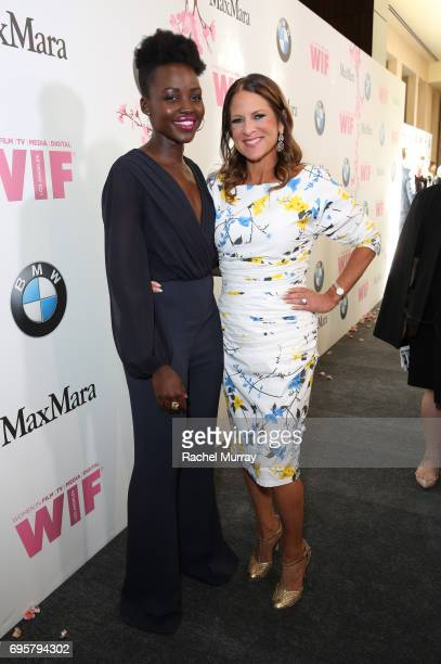 Actrees Lupita Nyong'o and President of Women In Film Cathy Shulman both wearing Max Mara at Women In Film 2017 Crystal Lucy Awards presented By Max...