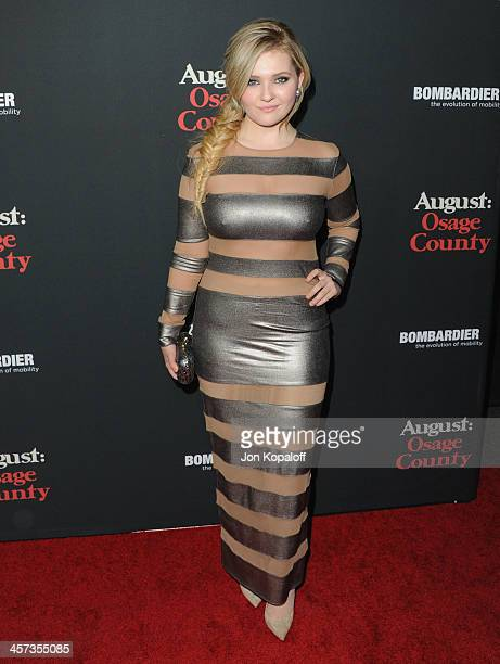 Actress Abigail Breslin arrives at the Los Angeles Premiere 'August Osage County' at Regal Cinemas LA Live on December 16 2013 in Los Angeles...