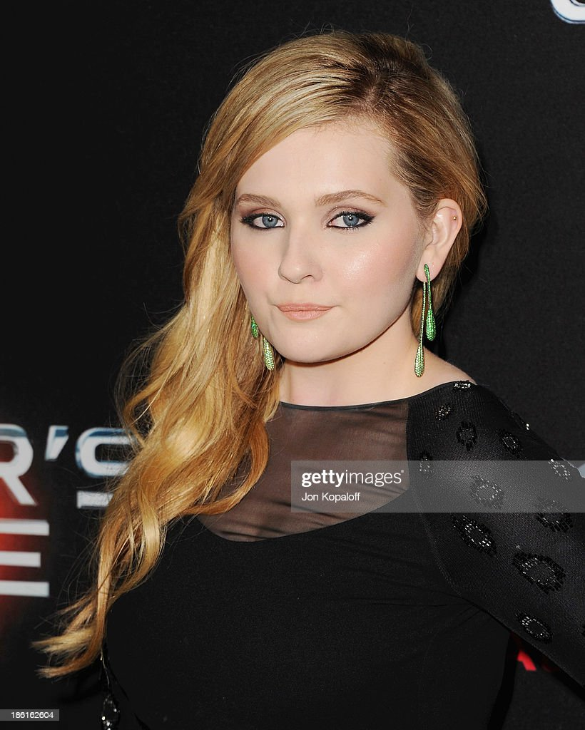 Actress Abigail Breslin arrives at the Los Angeles Premiere 'Ender's Game' at TCL Chinese Theatre on October 28 2013 in Hollywood California