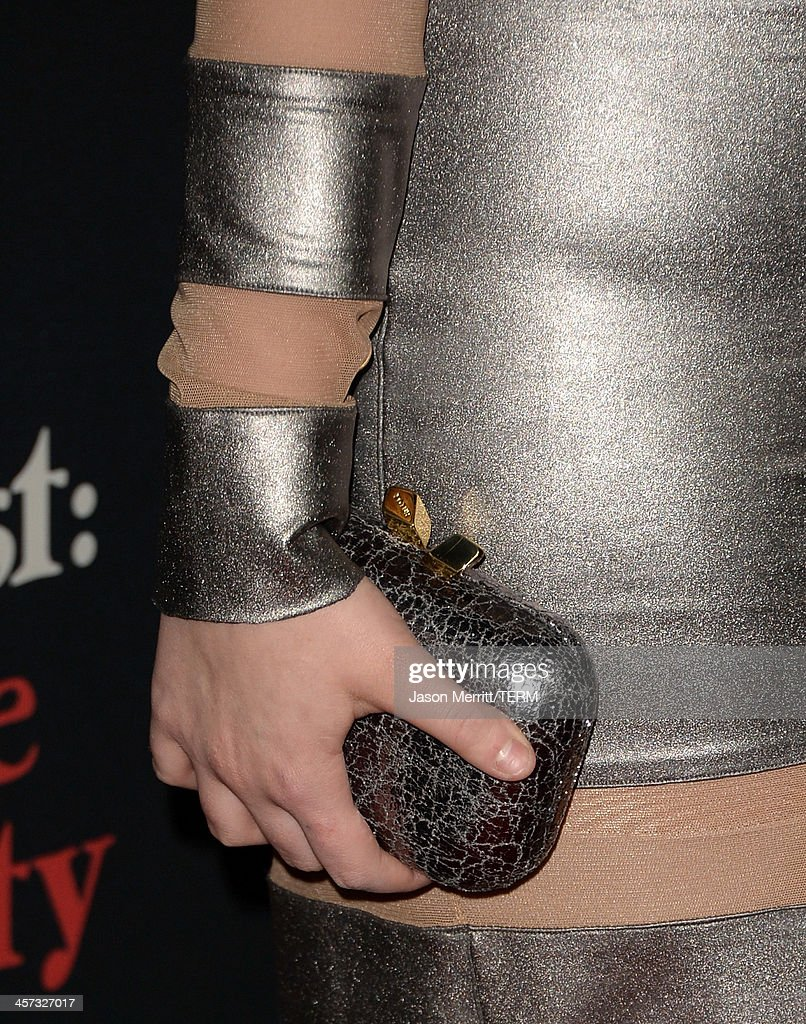 Actress Abigail Breslin (clutch detail) arrives at the premiere of The Weinstein Company's 'August: Osage County' at Regal Cinemas L.A. Live on December 16, 2013 in Los Angeles, California.