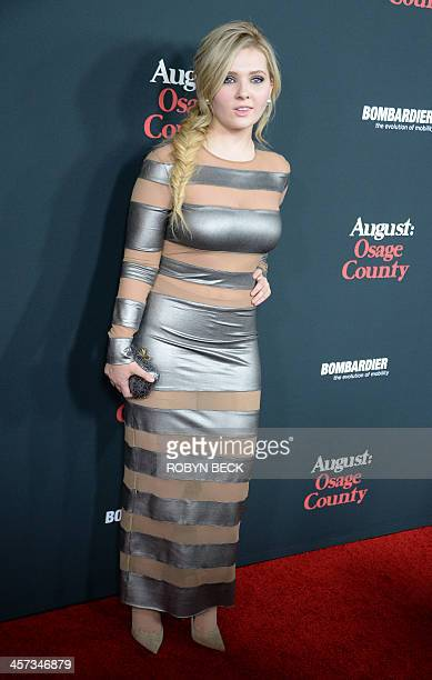 Actress Abigail Breslin arrives for the premiere of 'August Osage County' December 16 2013 at the Regal Cinemas at LA Live in Los Angeles California...