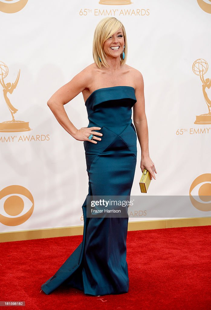 Actress Actress Jane Krakowski (with Judith Leiber Couture Jellybean Crocodile Rectangle Clutch in Chartreuse) arrives at the 65th Annual Primetime Emmy Awards held at Nokia Theatre L.A. Live on September 22, 2013 in Los Angeles, California.