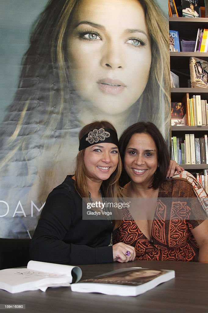 Actress <a gi-track='captionPersonalityLinkClicked' href=/galleries/search?phrase=Adamari+Lopez&family=editorial&specificpeople=2550892 ng-click='$event.stopPropagation()'>Adamari Lopez</a> and Elainne Sanchez attend <a gi-track='captionPersonalityLinkClicked' href=/galleries/search?phrase=Adamari+Lopez&family=editorial&specificpeople=2550892 ng-click='$event.stopPropagation()'>Adamari Lopez</a>'s book signing for her book 'Viviendo' at Libros AC on January 13, 2013 in San Juan, Puerto Rico.