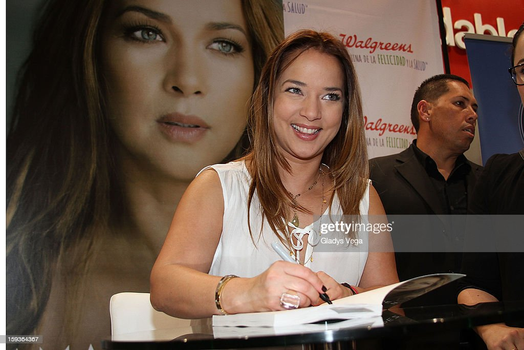 Actress <a gi-track='captionPersonalityLinkClicked' href=/galleries/search?phrase=Adamari+Lopez&family=editorial&specificpeople=2550892 ng-click='$event.stopPropagation()'>Adamari Lopez</a> greets fans and signs copies of her book 'Viviendo' at Walgreens on January 12, 2013 in Guaynabo, Puerto Rico.
