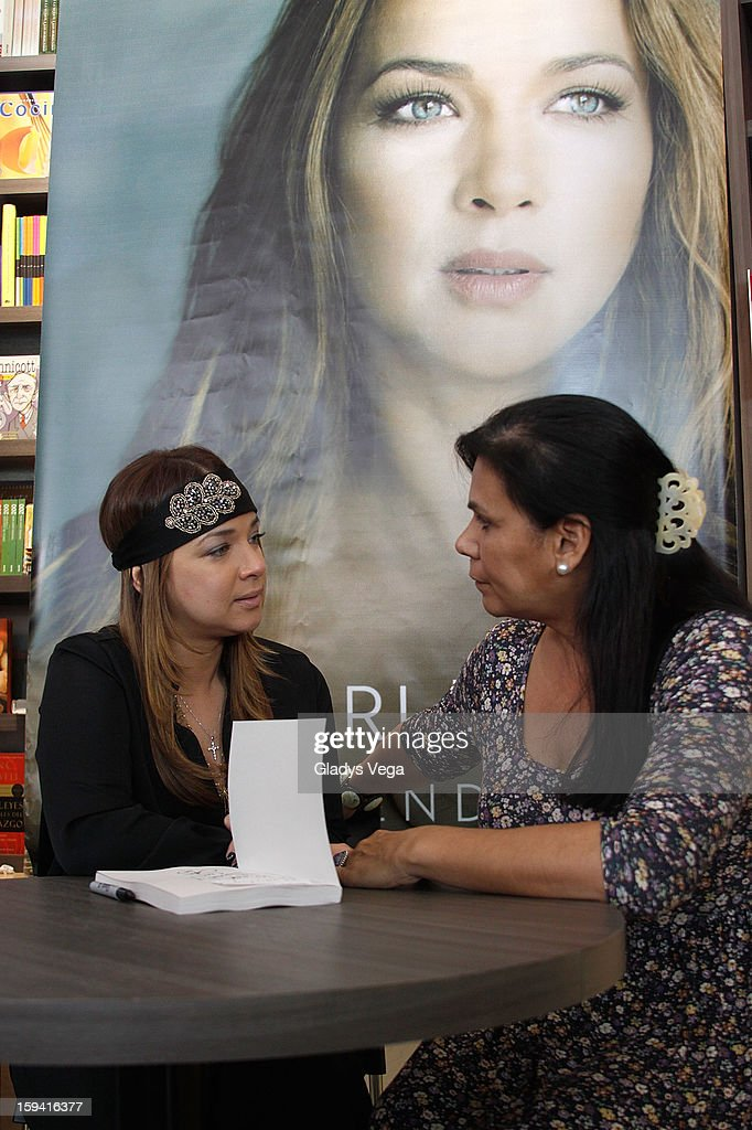 Actress <a gi-track='captionPersonalityLinkClicked' href=/galleries/search?phrase=Adamari+Lopez&family=editorial&specificpeople=2550892 ng-click='$event.stopPropagation()'>Adamari Lopez</a> greets fans and signs copies of her book 'Viviendo' at Libros AC on January 13, 2013 in San Juan, Puerto Rico.