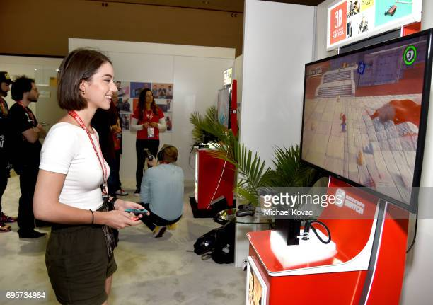Actress Adelaide Kane plays Super Mario Odyssey at the Nintendo booth at the 2017 E3 Gaming Convention at Los Angeles Convention Center on June 13...