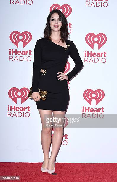 Actress Adelaide Kane poses in the press room during the 2014 iHeartRadio Music Festival at MGM Grand Garden Arena on September 20 2014 in Las Vegas...