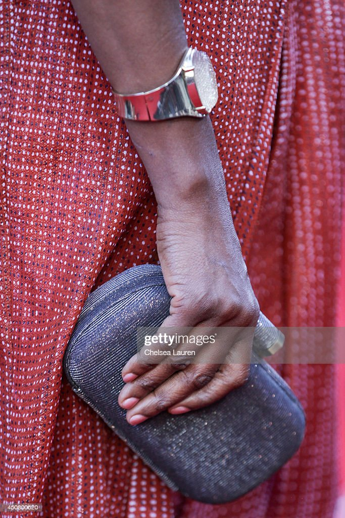 Actress Adina Porter (clutch detail and watch detail) arrives at HBO's 'True Blood' final season premiere at TCL Chinese Theatre on June 17, 2014 in Hollywood, California.