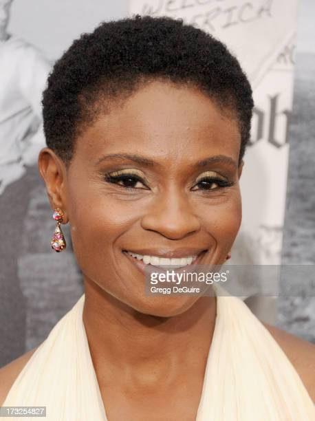 Actress Adina Porter arrives at the Los Angeles Season 2 premiere of HBO's series 'The Newsroom' at Paramount Studios on July 10 2013 in Hollywood...