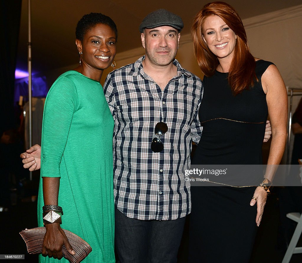 Actress <a gi-track='captionPersonalityLinkClicked' href=/galleries/search?phrase=Adina+Porter&family=editorial&specificpeople=2244592 ng-click='$event.stopPropagation()'>Adina Porter</a>, designer Octavio Carlin and model <a gi-track='captionPersonalityLinkClicked' href=/galleries/search?phrase=Angie+Everhart&family=editorial&specificpeople=206121 ng-click='$event.stopPropagation()'>Angie Everhart</a> share a moment backstage at the Octavio Carlin Spring 2014 collection show at Style Fashion Week on October 14, 2013 in Los Angeles, California.