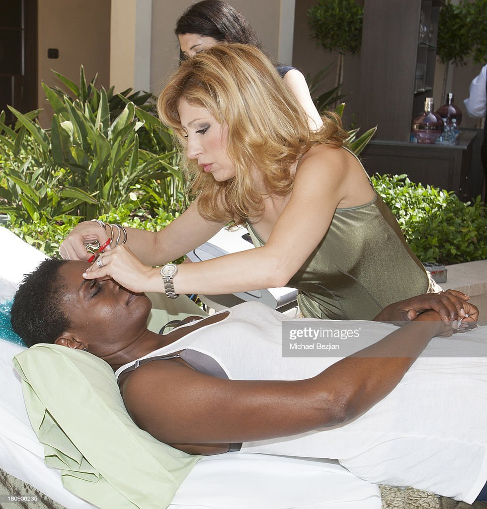 Actress Adina Porter gets spa services at Bellafortuna Luxury Gift Suite Presented By Feri on September 17, 2013 in Beverly Hills, California.