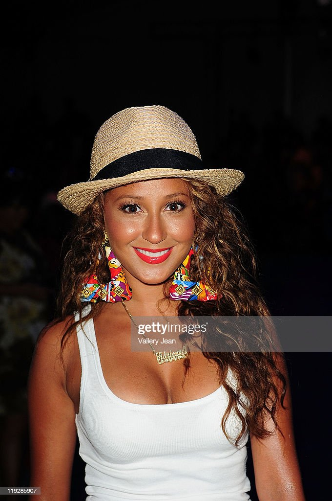 Actress <a gi-track='captionPersonalityLinkClicked' href=/galleries/search?phrase=Adrienne+Bailon&family=editorial&specificpeople=540286 ng-click='$event.stopPropagation()'>Adrienne Bailon</a> attends the Beach Bunny Swimwear show during Mercedes-Benz Fashion Week Swim 2012 at Raleigh Hotel on July 15, 2011 in Miami Beach, Florida.
