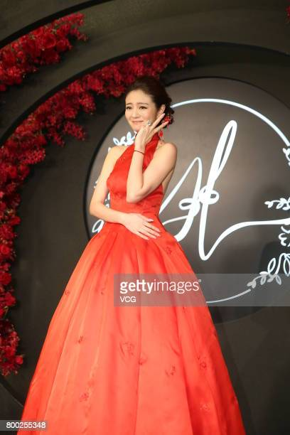 Actress Ady An arrives at the red carpet of her own banquet on June 23 2017 in Taipei Taiwan of China Macau businessman Levo Chan and actress Ady An...
