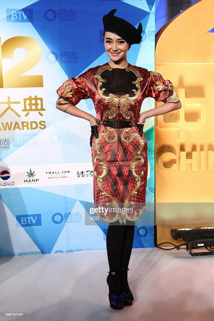Actress Ai Dai arrives at the red carpet of the 2012 China Trends Awards at BTV Grand Theater on December 22, 2012 in Beijing, China.