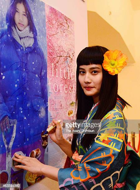 Actress Ai Hashimoto signs autograph during a stage greeting at the 'Little Forest' Culinary Cinema during the 65th Berlinale International Film...