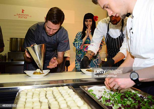 Actress Ai Hashimoto watch the kitchen of the Culinary Cinema during the 65th Berlinale International Film Festival on February 10 2015 in Berlin...