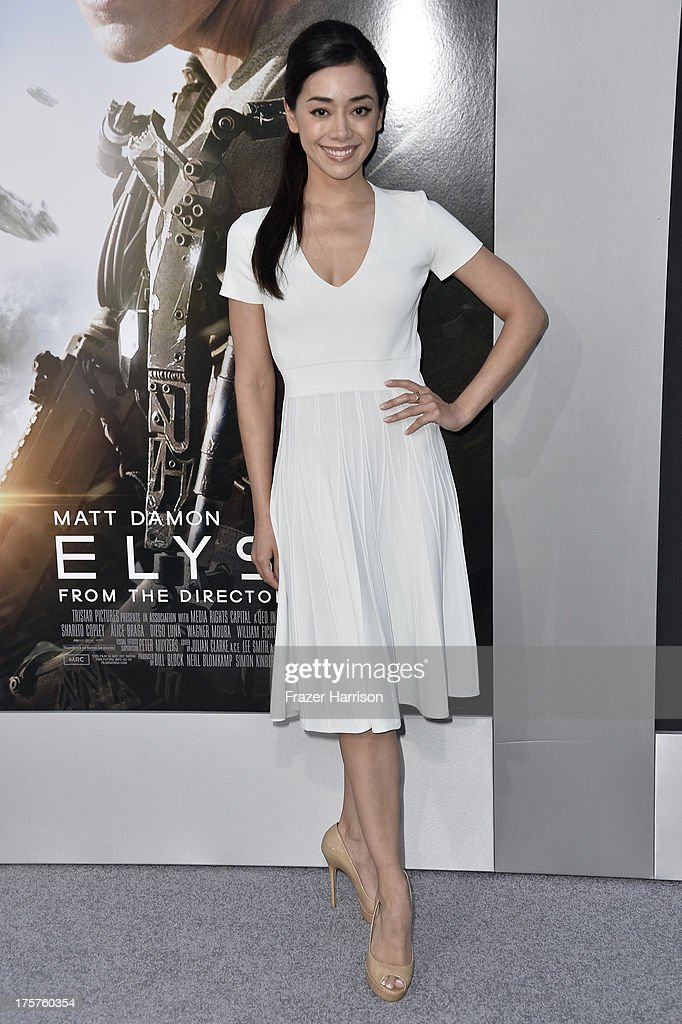 Actress Aimee Garcia arrives at the premiere of TriStar Pictures' 'Elysium' at Regency Village Theatre on August 7, 2013 in Westwood, California.