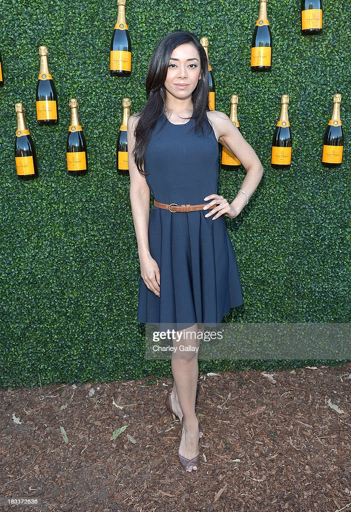 Actress <a gi-track='captionPersonalityLinkClicked' href=/galleries/search?phrase=Aimee+Garcia&family=editorial&specificpeople=561569 ng-click='$event.stopPropagation()'>Aimee Garcia</a> attends The Fourth-Annual Veuve Clicquot Polo Classic, Los Angeles at Will Rogers State Historic Park on October 5, 2013 in Pacific Palisades, California.