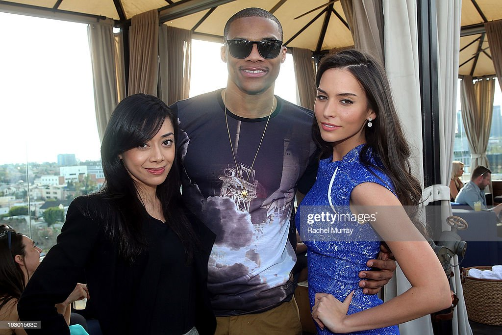 Actress Aimee Garcia, Russell Westbrook, and actress Genesis Rodriguez attend Flaunt Magazine and Samsung Galaxy celebrate The Plutocracy Issue release hosted by cover Russell Westbrook at Caulfield's Bar and Dining Room at Thompson Hotel on March 2, 2013 in Beverly Hills, California.