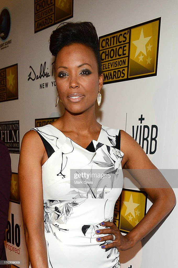 Actress <a gi-track='captionPersonalityLinkClicked' href=/galleries/search?phrase=Aisha+Tyler&family=editorial&specificpeople=202262 ng-click='$event.stopPropagation()'>Aisha Tyler</a> arrives at Broadcast Television Journalists Association's third annual Critics' Choice Television Awards at The Beverly Hilton Hotel on June 10, 2013 in Los Angeles, California.