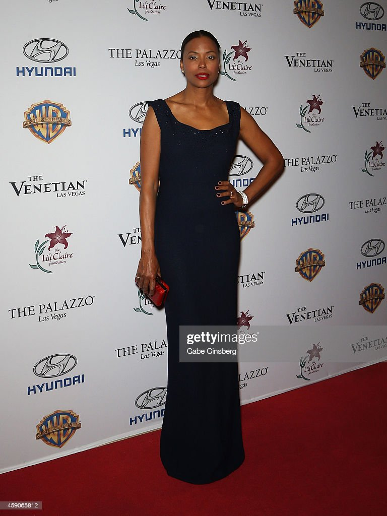 Actress <a gi-track='captionPersonalityLinkClicked' href=/galleries/search?phrase=Aisha+Tyler&family=editorial&specificpeople=202262 ng-click='$event.stopPropagation()'>Aisha Tyler</a> arrives at Live Your Passion Celebrity Benefit at The Venetian Las Vegas on November 15, 2014 in Las Vegas, Nevada.