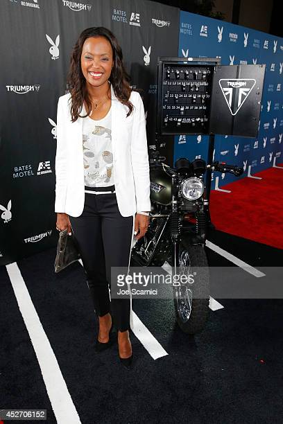 """Actress Aisha Tyler attempts to start the engine for charity of the Triumph Scrambler Custom on display at the Playboy and AE """"Bates Motel"""" Event..."""
