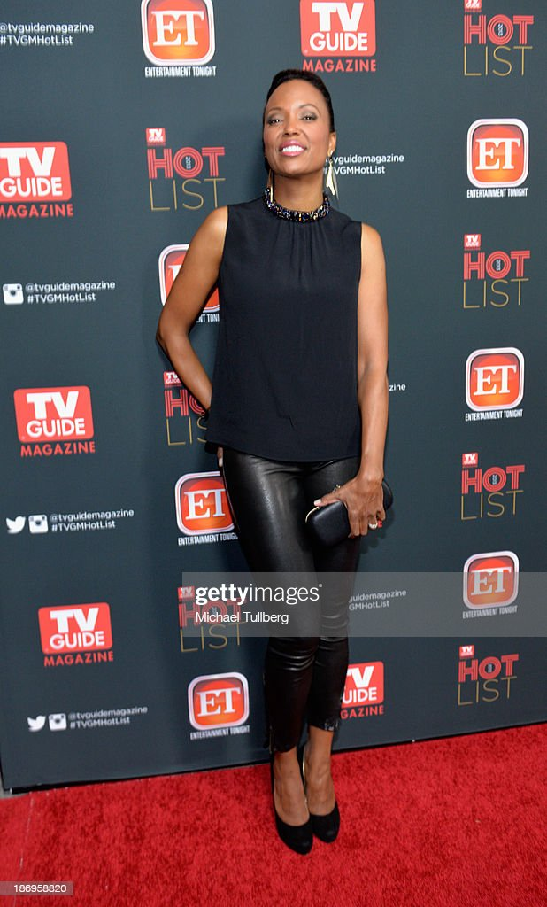 Actress <a gi-track='captionPersonalityLinkClicked' href=/galleries/search?phrase=Aisha+Tyler&family=editorial&specificpeople=202262 ng-click='$event.stopPropagation()'>Aisha Tyler</a> attends TV Guide Magazine's Annual Hot List Party at The Emerson Theatre on November 4, 2013 in Hollywood, California.