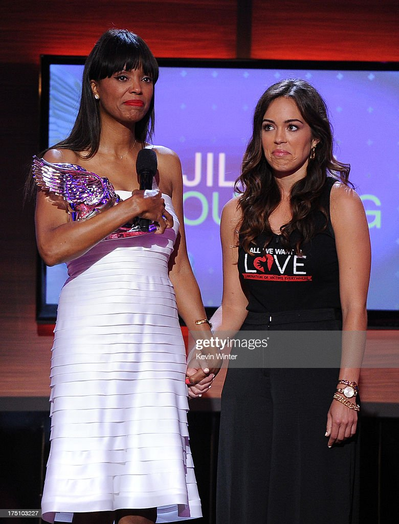 Actress <a gi-track='captionPersonalityLinkClicked' href=/galleries/search?phrase=Aisha+Tyler&family=editorial&specificpeople=202262 ng-click='$event.stopPropagation()'>Aisha Tyler</a> presents award to Jillian Mourning of All We Want Is L.O.V.E. onstage at the DoSomething.org and VH1's 2013 Do Something Awards at Avalon on July 31, 2013 in Hollywood, California.