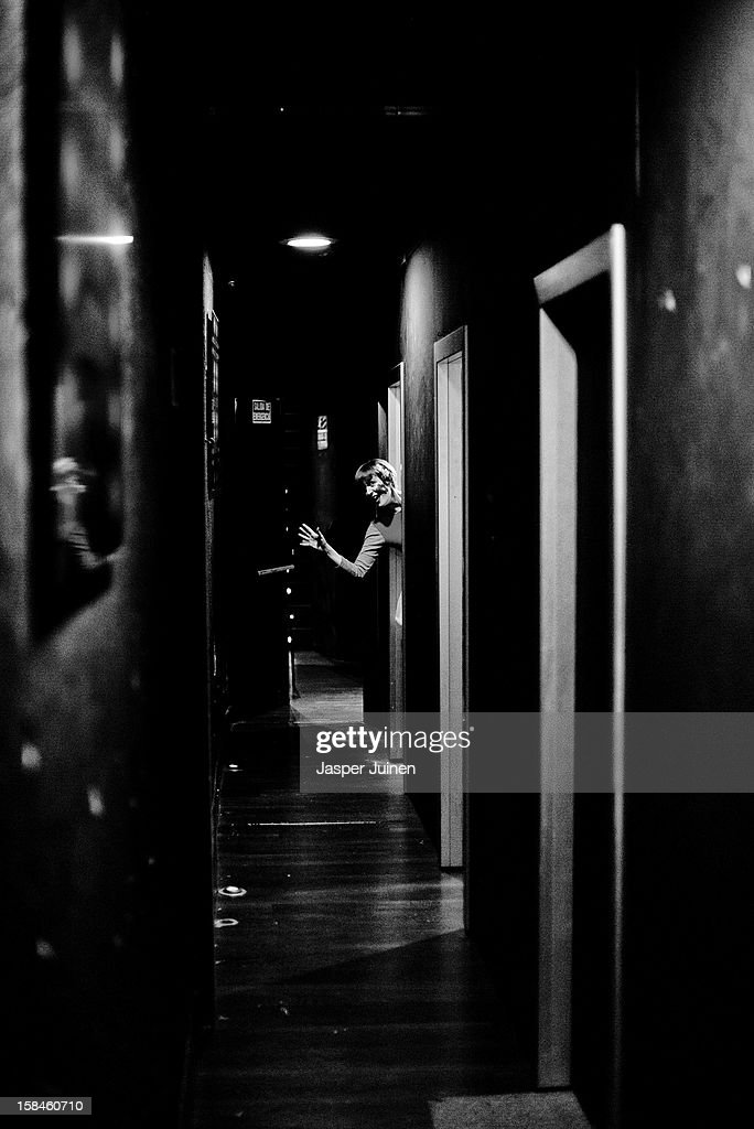 Actress Aixa Villagran screems at colleague actors, inside the other rooms, wishing them good luck moments before the spectators enter to view the micro theater shows at the 'Micro Teatro por Dinero' on December 15, 2012 in Madrid, Spain. In November 2009, fifty artists presented a theatre project in the thirteen rooms of a former brothel, two weeks before its demolition, with each function lasting less than 10 minutes. The initiative was a huge success, with more people queueing up outside than could enter. Today's 'Micro Theatre For Money' is named after the former brothel on Ballesta Street, and offers a cheap and original way for going out at night, especially in times of financial hardship. With each show priced at 4 Euros, over 150,000 spectators have already attended performances at the tiny theatre in the Malasana area. Anyone can submit a project to be chosen to perform for a month in one of the five tiny rooms in the basement of the theatre, making it an ideal platform for young Spanish authors and actors, often unemployed, to perform.