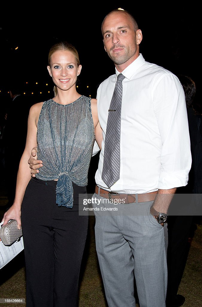 Actress A.J. Cook (L) and her husband Nathan Andersen arrive at the ACT Today!'s 7th Annual Denim & Diamonds For Autism Benefit on November 3, 2012 in Malibu, California.