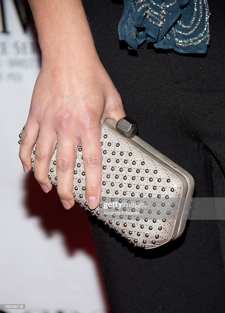 Actress A.J. Cook (handbag detail) arrives at the ACT Today!'s 7th Annual Denim & Diamonds For Autism Benefit on November 3, 2012 in Malibu, California.