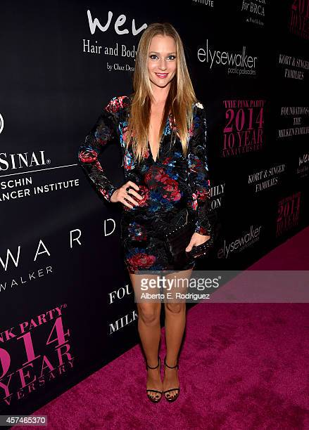 Actress AJ Cook attends Elyse Walker presents the 10th anniversary Pink Party hosted by Jennifer Garner and Rachel Zoe at HANGAR8 on October 18 2014...
