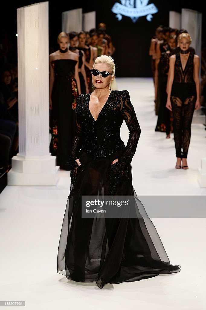 Actress Ajda Pekkan walks the runway at the Raisa-Vanessa Sason show during Mercedes-Benz Fashion Week Istanbul s/s 2014 Presented By American Express on October 10, 2013 in Istanbul, Turkey.