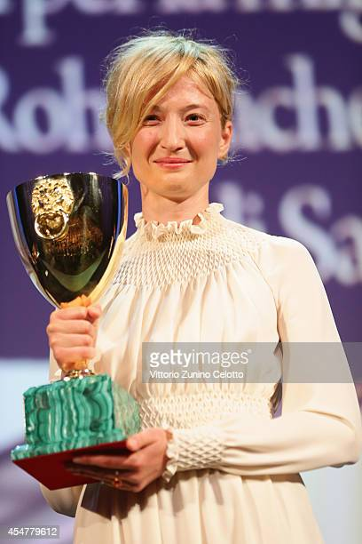 Actress Alba Rohrwacher poses on stage with her Best Actress award for Hungry Hearts on stage during the Closing Ceremony of the 71st Venice Film...