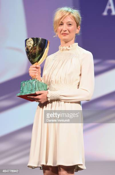Actress Alba Rohrwacher poses onstage with the Best Actress award she received for her role in the movie 'Hungry Hearts' during the closing ceremony...