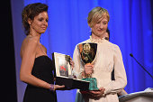 Actress Alba Rohrwacher poses with her Best Actress award for 'Hungry Hearts' with a JaegerLeCoultre engraved Reverso watch on stage during the...