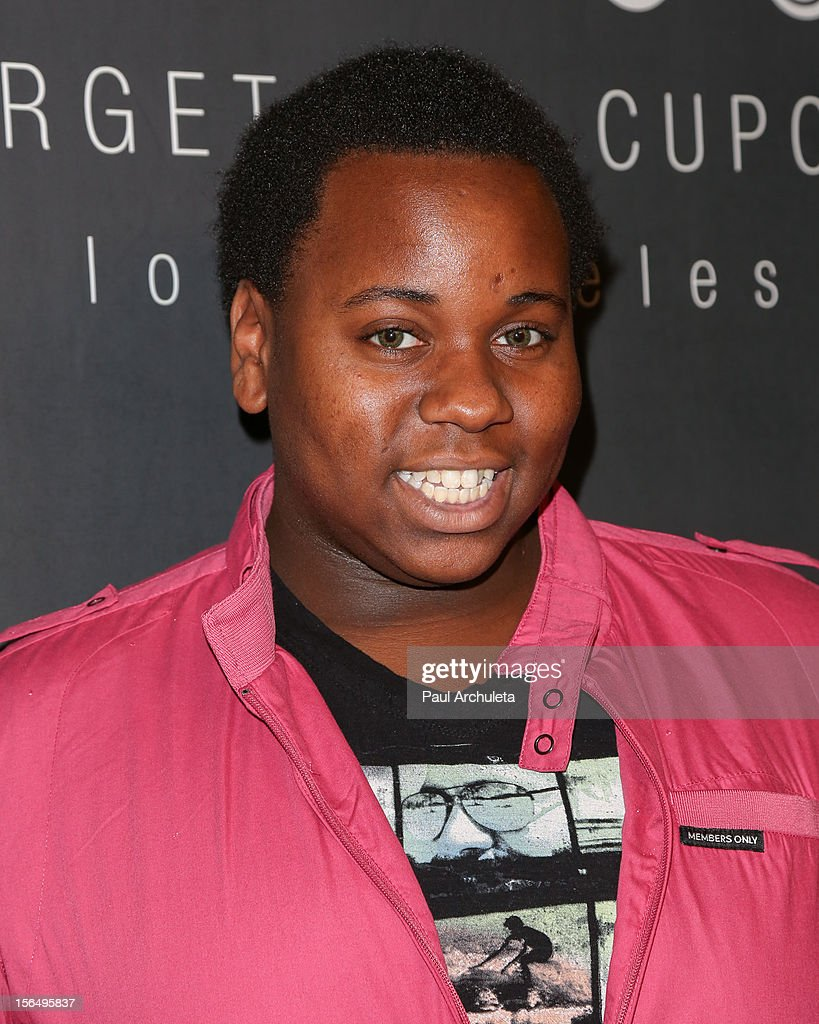 Actress Alex Newell attends the Georgetown Cupcakes Los Angeles grand opening at Georgetown Cupcake Los Angeles on November 15, 2012 in Los Angeles, California.