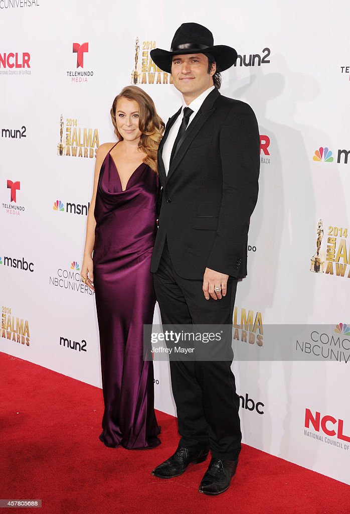 Actress Alexa PenaVega and director Robert Rodriguez arrive at the 2014 NCLR ALMA Awards at Pasadena Civic Auditorium on October 10 2014 in Pasadena...