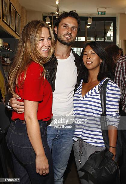 Actress Alexandra Neldel actor Simon Verhoeven and actress MinhKhai PhanThi attend the Kiehl's 'Take Care' Charity event at the Berlin Kiehl store on...