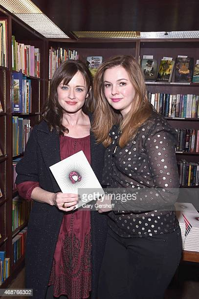 Actress Alexis Bledel and actress/writer Amber Tamblyn attend the Amber Tamblyn 'Dark Sparkler' Book Release Party at Housing Works Bookstore Cafe on...